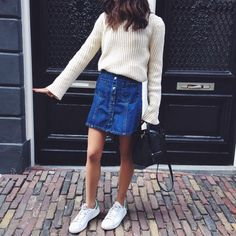 Transition through the seasons by adding a sweater to your denim mini skirt.