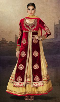 Look radiant and ravishing in this cream and pink shade net velvet churidar suit. This desirable attire is displaying some astounding embroidery done with lace, patch, resham and stones work. #AwesomeDesignerWear