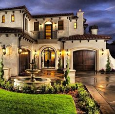 """Mediterranean Exterior of Home with Pathway, exterior stone floors, Fountain, One Piece """"S"""" Mission Clay Roof Tiles"""