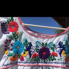 These pretty embroidered flowers make a cheery dress. Cool cotton could even be a fancy nightgown.