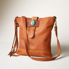 ALVARADO CROSSBODY Bag from Sundance Catalog -- Handmade in Texas using time-honored traditions. This leather crossbody bag would go perfectly with any boho chic or western wear outfit. Accented with a vintage belt buckle closure and natural, turquoise stone. Each is unique.