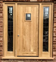 Oak front door, frame & side lights set - Made for a customer in Dunham-on-the-hill, Chester. Constructed using prime grade solid european oak. The set includes door, side lights, frame, glazing, stormguard weather bar and locks. Made to measure.