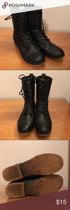 Black combat boots (Women's 6.5) Used twice. I'm a size 6 and thought 6.5 wouldn't much of a difference, but they were too big. Slight scuffing on the bottom of boots, not noticeable while wearing. Open to negotiate price. Forever Shoes Combat & Moto Boots