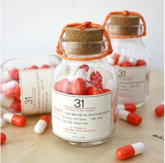 31 orange pill capsule letter bottle set - You put little notes in the plastic capsules. They're so cute!