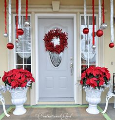poinsettias on porch, really like the ornaments on ribbon