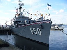 """USS JOSEPH P. KENNEDY, JR. DD850 Destroyer USS Joseph P. Kennedy, Jr., known by her crew as the """"Joey P.,"""" was laid down April 2, 1945, by the Bethlehem Steel Company at the Fore River Shipyard in Quincy, MA. Launched on July 26, 1945, and commissioned on December 15, 1945, she was completed in only 8 months, reflective of the fast pace of shipbuilding during the last year of the Second World War."""
