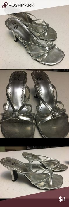 Size 5 1/2 silver dress shoes/sandals It's OK size 5 1/2 silver heeled strap dress shoes/sandals in good condition. Some glue is exposed on some of the straps near the sole (pictured), but it's really not noticeable while wearing the heels. Shoes Heels