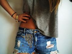 Distressed studded cutoffs.