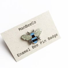 Bee enamel pin badge in Manchester City Blue + Black