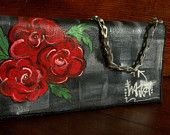 Hand Painted Denim Clutch Bag ... Definitely wearable art!  Red roses on a dark smokey background will add a little drama to whatever you wear. You have got to see these clutches in action. The more you use them the better they get!  See my entire collection at www.marionrenee.com and to see what's current just click on the photo. $58    hand painted, denim, chain, roses, clutch, purse, bag, painting, art  one of a kind, chic!