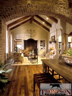 Love the defining brick arch, and substantial rustic beams...