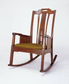 Rocking chair of Honduras mahogany and ebony with upholstered seat :: Greene and Greene Digital Archive