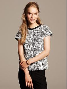 What's in My Carry On: I love a animal printed tee so versatile  and easy to mix and match with other items.
