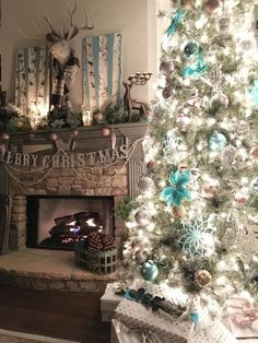 A look of fresh snow, in cool icy blues. Lots of metallics on the beautiful Balsam Hill Christmas Tree. Filled with  ideas in metallics and turquoise aqua. AD. Refresh Restyle