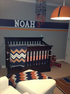 Basketball inspired bedding; ikea ceiling lamp turned into a basketball and mobile done by me!