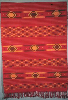Africa | An ikaki-pattern textile from Akwete. Igbo peoples of southern Nigeria. | Photo by Lisa Aronson. ||| Once woven in three parts, like its Ijebu equivalent, ikaki cloth came to be woven in one wide version. Yet, the multiple part construction is still evident in its overall design.