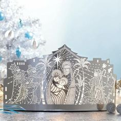 "ENCHANTED NATIVITY VOTIVE HOLDER : The magic of the Holy Night is captured in a shimmering display of photo-etched metal. Includes three glass cups for use with votives or tealights, sold separately. 7½""h, 12¾""w. by PartyLIte"