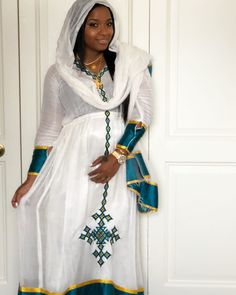 Today was my godsons christening. It was absolutely beautiful! I'm Feeling like the queen that I am in my Habesha dress.I love Ethiopian & Eritrean clothing. So beautiful! Beautiful Ethiopian Women, Ethiopian Beauty, Ethiopian Wedding Dress, Ethiopian Dress, African Wear, African Dress, African Fashion, Habesha Kemis, Eritrean