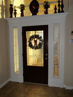 front door ideas Even if we can't add glass, we could make a grander entrance with fancier framing and moulding!