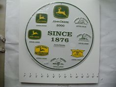 NEW JOHN DEERE METAL ROUND SIGN HISTORY OF LOGOS 1876 TO 2000 MOLINE ILLINOIS  #JohnDeere