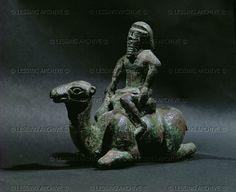 ASSUR SCULPTURE 10TH-6TH BCE Man on crouching camel. Bronze figurine. Period of Sennacherib (704-681 BCE) from Niniveh, Mesopotamia (Iraq) British Museum, London, Great Britain