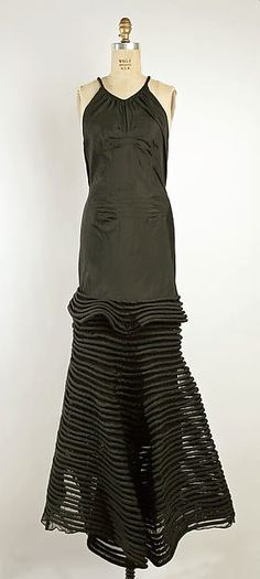 Evening dress - Front Design House: Attributed to House of Lanvin (French, founded 1889) Designer: Attributed to Jeanne Lanvin (French, 1867–1946) Date: ca. 1933 Culture: French Medium: silk, cotton Dimensions: Length at CF: 57 1/2 in. (146.1 cm) Credit Line: Gift of Gabriella de Balogh, 1984