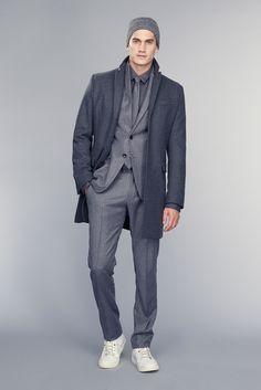 How to wear: charcoal overcoat, grey vertical striped suit, charcoal dress shirt, white low top sneakers Fashion Moda, Fashion Week, Men's Fashion, Mens Fashion Suits, Mens Suits, Suit Men, Banana Republic, Manuel Ritz, Men's Collection