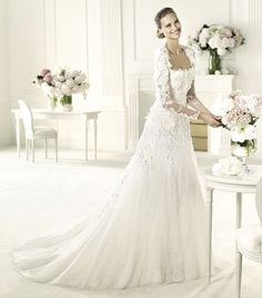 Covering it up beautifully with a closed back and full sleeves. --- Elie Saab wedding dress collection 2013