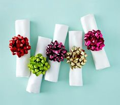 Use holiday bows to make festive napkin rings.