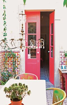 """Cumberbatch traveled to the fishing town of Olhão in Portugal for inspiration, where painter Antonia Williams covered her terrace door in a unique shade of pink-red. """"I probably wouldn't have been brave enough without the enthusiasm of a friend,"""" she tells Cumberbatch in the book, """"but the red seems to complement the yellows in the courtyard, and contrasts well with the huge tropical plants."""""""