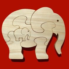 Items similar to Elephant With Calf - Childrens Wood Puzzle Game - New Toy - Hand-Made - Child-Safe on Etsy Scroll Saw Patterns, Wood Patterns, Woodworking Toys, Woodworking Projects, Wooden Puzzles, Wooden Crafts, Wood Toys, Diy Toys, Stuffed Toys Patterns
