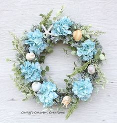 Finding a coastal decor mood before starting will allow you to pre-plan your decisions for your space so that you are more likely to attain the coastal decor feel that you want when you conclude. Coastal Wreath, Seashell Wreath, Nautical Wreath, Seashell Art, Coastal Decor, Seashell Crafts, Beach Wreaths, Coastal Interior, Seaside Decor