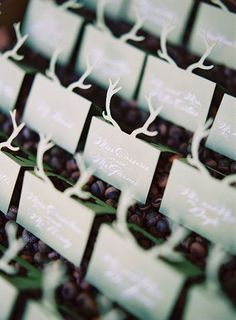Paper antler escort cards are perfect for a rustic winter wedding | Brides.com