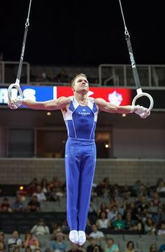 Jonathan Horton holds an iron cross on the rings during the 2012 USA Gymnastics Olympic Trials prelims.  He led the event standings after night one.