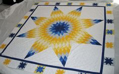 Lone Star quilt, i like the way it is set with the border of stars.