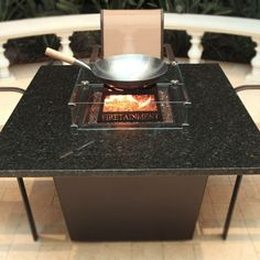 """The 44"""" Square Venice fire table seats 4-6 people comfortably depending on the seating style. There is ample space from the edge of the table tops to the burner pan allowing for space to dine."""