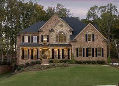 Stone and brick combine for a timeless and distinctive look. Newly built homes in the Stonehaven at Sugarloaf community by John Wieland Homes. Lawrenceville, GA.