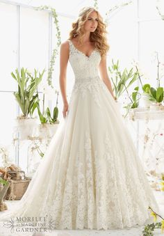 "Wedding Dresses and Wedding Gowns by Morilee featuring Classic Tulle Ball Gown with Crystal Beaded, Alencon Lace Appliques and Wide Scalloped Hemline Removable Beaded Satin Belt. Available in Three Lengths: 55"", 58"", 61"". Colors available: White, Ivory, Ivory/Light Gold"