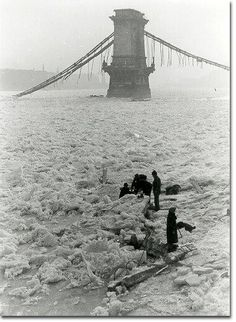 Frozen over Danube, destroyed chain bridge. 1945.