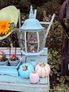 Salvaged vintage lantern light fixture as repurposed bird feeder