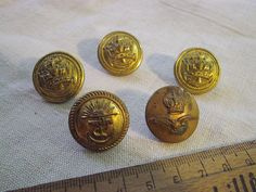 Vintage British Military Brass Buttons - Royal Marine and Royal Air Force 5 buttons in total. Listed as a whole lot. all buttons are about