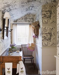 Toile All Over:   Rooms under eaves can feel cramped, but designer Tom Scheerer masked this low slope by covering it in an aviary-patterned toile that seems to open up the whole space.