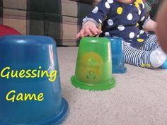 Playing to Learn: Guessing Game. Fine motor skills and problem solving for infants.