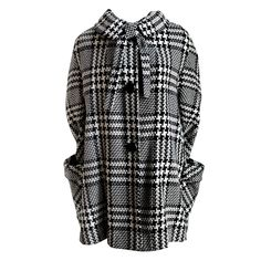 1960's wool houndstooth swing coat with neck tie | From a collection of rare vintage coats and outerwear at http://www.1stdibs.com/fashion/clothing/coats-outerwear/