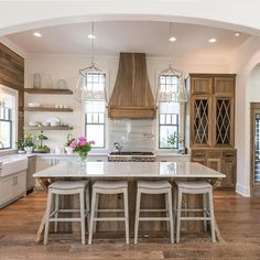 """Mixed materials standout in this Florida beach home. Designer and Gabby #StyleMaker Cynthia Rice suggests clients, """"pull the whole look together with your bar stools"""". We love the #GabbyHome stools she chose for this warm space! #gabbystyle #dreamhome #kitchen #designer #interiordesign #coastal #beachhome #homesweethome #interiorinspo #barstools #warm #inviting"""