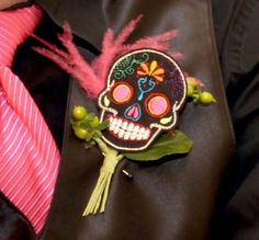 This skull boutonniere is perfect for a Dia de los Muertos wedding party