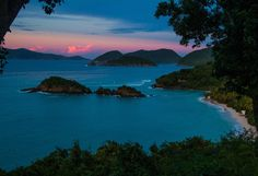 Virgin Islands National Park is a tropical paradise with breathtaking hills, valleys and beaches. With 7,000-plus acres on the island of St. John, Virgin Islands National Park offers snow-white sand dotted by palm trees, coral reefs, pre-historic sites and Bay Rum Tree forests. Pictured here is sunset over the park's Trunk Bay -- considered one of the most beautiful beaches in the world. Photo by Kerry Childers (www.sharetheexperience.org). — at Virgin Islands National Park.