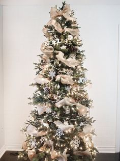 The Christmas season is here! And that means decorating your tree! My family always picks a day and decorates the tree together. I hope you are inspired by these beautiful Christmas tree ideas! Christmas Tree Ribbon Garland, Elegant Christmas Trees, Silver Christmas Decorations, Traditional Christmas Tree, Gold Christmas Tree, Christmas Tree Themes, Christmas Tree Toppers, Rustic Christmas, Christmas Lights