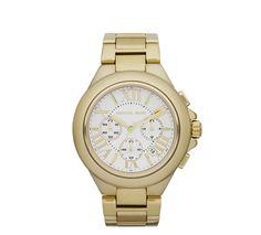 Michael Kors http://www.vogue.fr/mode/shopping/diaporama/cadeaux-de-noel-gold-fever/10806/image/649167#michael-kors