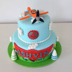 easy airplane cake blue frosting marshmallows toy airplane
